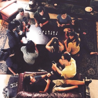 Iraqi/Jordanian and American students sitting on a rug from Cairo, Egypt, playing spoons on a table that was made by a Palestinian carpenter in Amman, Jordan. More of this God, please! We want so much more of this.